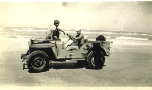 2 sailors in jeep by water